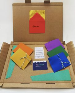 The inside of a Participation Box with multicoloured envelopes